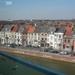 Mechelen en de Dijle vanachter een raam
