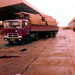 Velting Pegaso, open trailer hout geladen.
