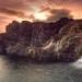 hd-achtergrond-met-rotsen-waterval-en-zee