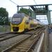 Een VIRM komt over de spoorbrug net voor station Alkmaar.