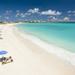 prachtig-zandstrand-en-een-blauwe-zee-hd-zomer-achtergrond