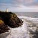 hd-landschap-wallpaper-met-zee-en-een-vuurtoren-op-de-rotsen-acht